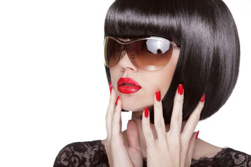 Fashion portrait of brunette woman in sunglasses showing red man