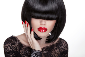 Beautiful brunette woman with hairstyle and red lips, manicured