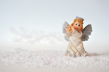Christmas angel and snow on white background