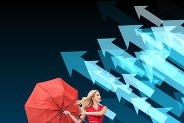 Composite image of beautiful woman posing with a broken umbrella