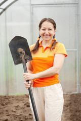 Happy  woman  with  spade