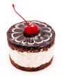 Chocolate cake with cherry on the top icing isolated