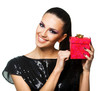 Beautiful woman holding a red gift over a white background