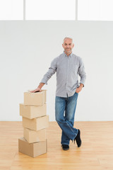 Mature man with boxes in a new house