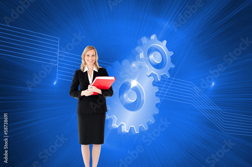 Composite image of businesswoman smiling and holding folders