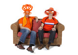 Two Dutch soccer fan watching game over white background