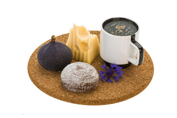Breakfast with coffee, cake, fig and cheese
