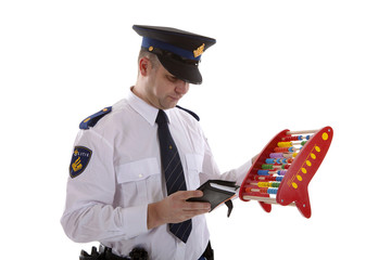 Dutch police officer is counting vouchers quotas with abacus ove