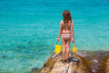 Kid girl rear view in beach tropical turquoise water