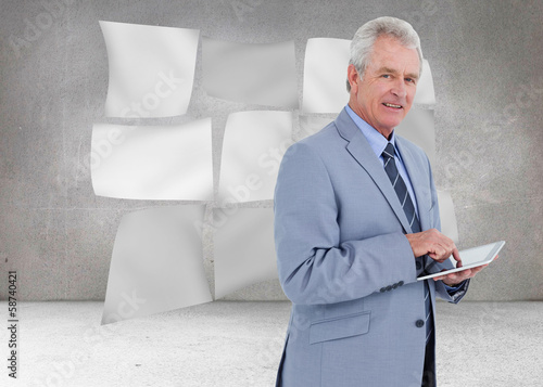 Composite image of side view of mature tradesman with tablet com