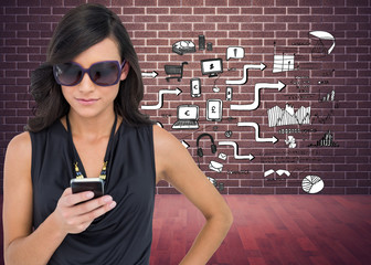 Composite image of happy brunette using smartphone