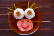 Funny kid food with rice and meat smiley face