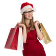 Happy woman holiday buyer wearing Santa hat and red dress