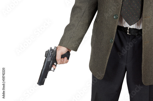 Man holds a pistol in his hand