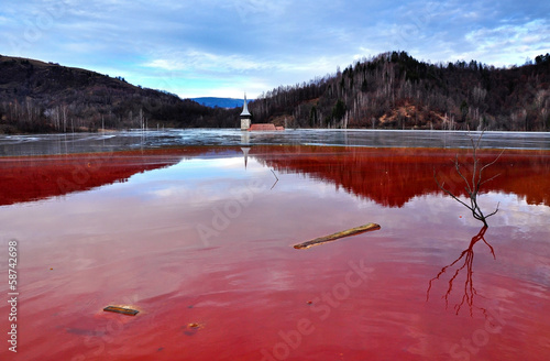 A flooded church in a toxic red lake - 58742698