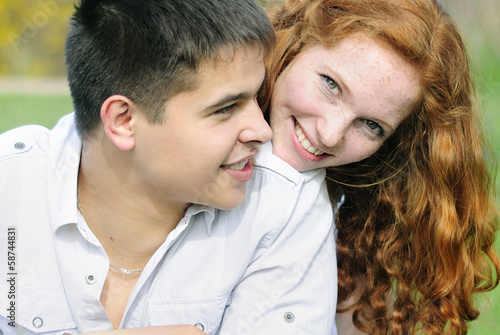 beautiful young couple in love on a green glade
