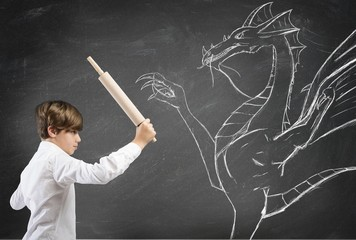 Brave boy fighting a dragon