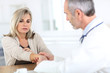 Senior woman with wrist pain consulting doctor