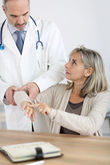 Patient consulting doctor for elbow pain