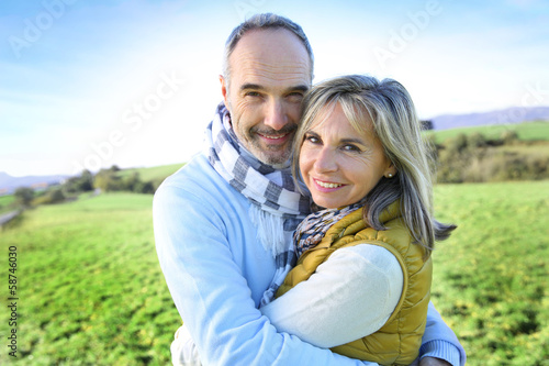 Senior couple embracing in countryside
