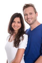 Glückliches junges Paar isoliert auf weiß