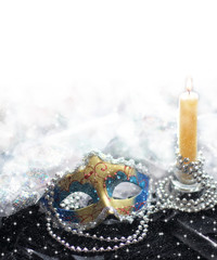 Christmas background with mask and candle