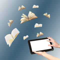 Tablet and opened books on blue background