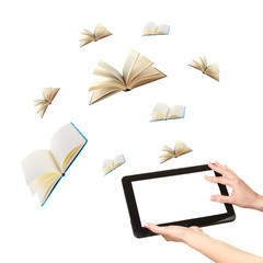 Tablet and opened books isolated on white