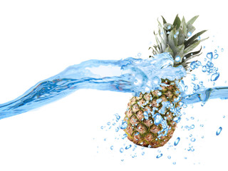 Pineapple dropped into water