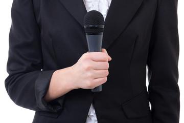 black microphone in female journalist's hand