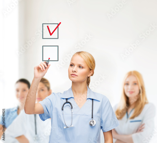 doctor or nurse drawning checkmark into checkbox