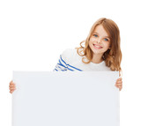 smiling little girl with blank white board