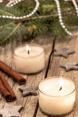 christmas candles over a old wood background