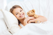 little girl with teddy bear sleeping at home