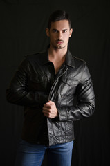 Portrait of attractive young man with leather jacket and jeans