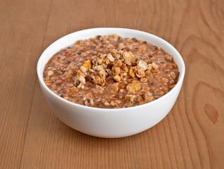 Oatmeal on wooden board. breakfast