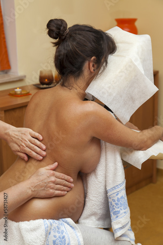 Young pregnant woman receiving relaxing prenatal massage