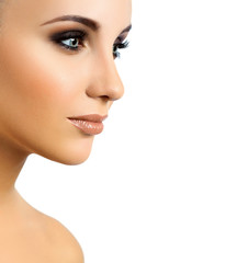 portrait of a beautiful girl on a light background. makeup