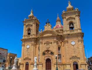 Xaghra church with statues at its entrance in Gozo, Malta.