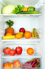 Vegetables and fruits in open refrigerator. Weight loss diet