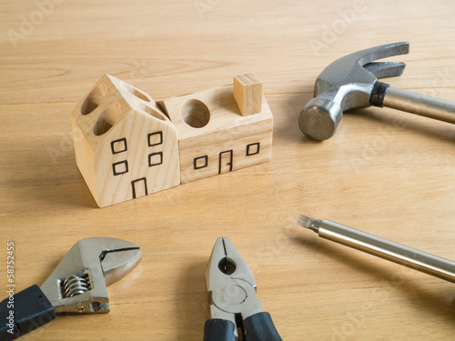 Set of tools and wood house toy.