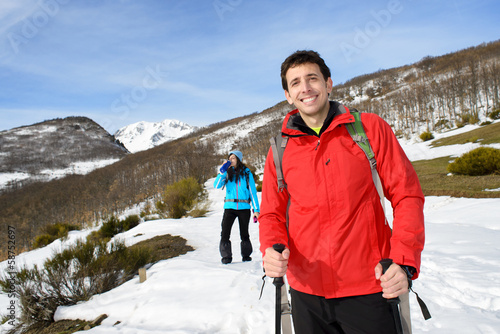 Couple in winter hiking trip