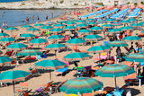 Crowded beach with umbrellas, Vieste, Apulia, Gargano,Italy