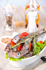 redfish on the kitchen table with vegetables and spices