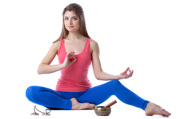 Image of beautiful brunette meditating in studio