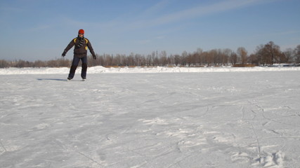 Man Ice skating on the lake