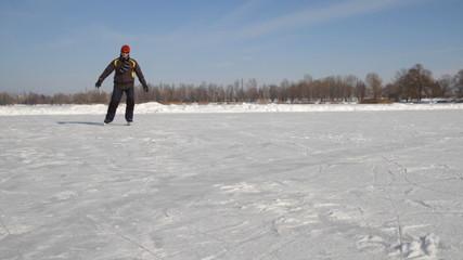Man Ice skating on the lake