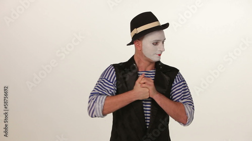 male mime in a hat, close-up