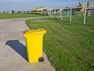 Trash can standing alone on modern cow farm