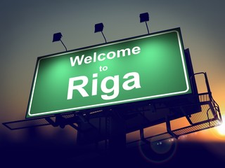 Billboard Welcome to Riga at Sunrise.